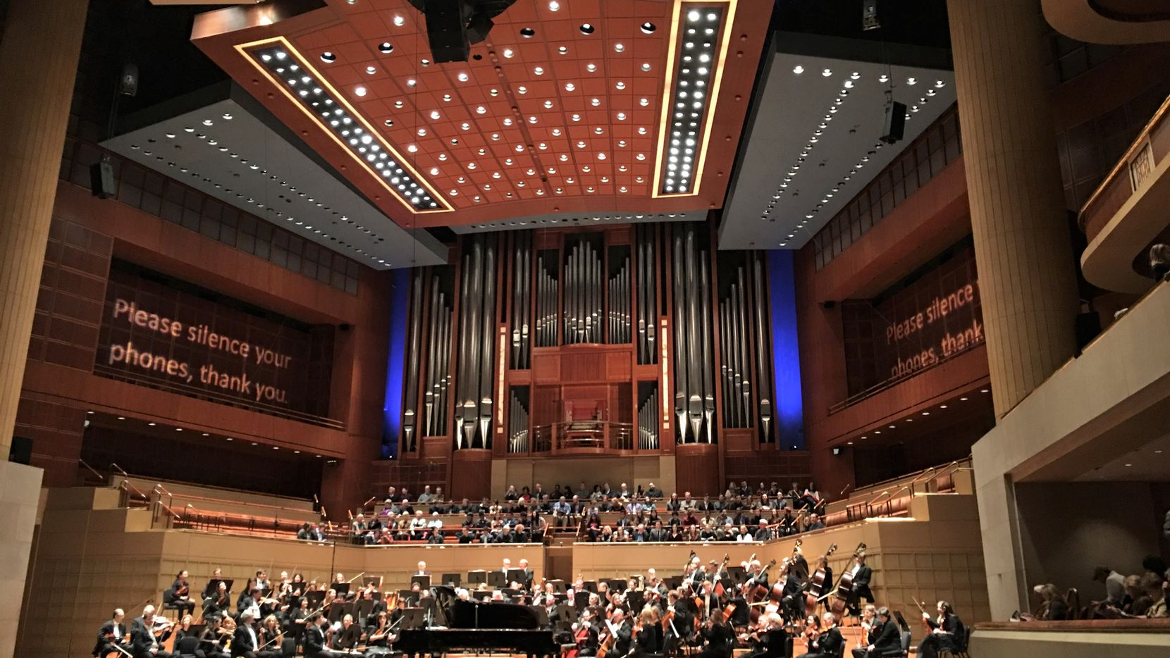 The Dallas Symphony Orchestra prepares to play the Philip Glass Double Concerto for two pianos, with duo pianists Katia and Marielle Labèque, and music director Jaap van Zweden conducting, on Feb. 2, 2018 at the  Meyerson Symphony Center. (Scott Cantrell/Special Contributor)