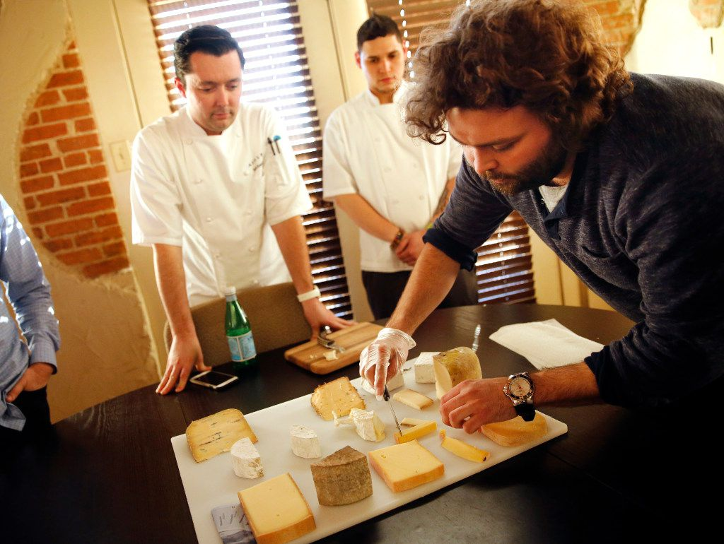 Adolphus Hotel chef Michael Ehlert (left) and sous chef David Gomez (center) watch as Regalis TX cheese specialist Travis Hughes serves up a cheese tasting in their Texas Ice House offices, Wednesday, February 1, 2017.  The Adolphus contingent is shopping for foods and services for The French Room which is being renovated along with the hotel in downtown Dallas.