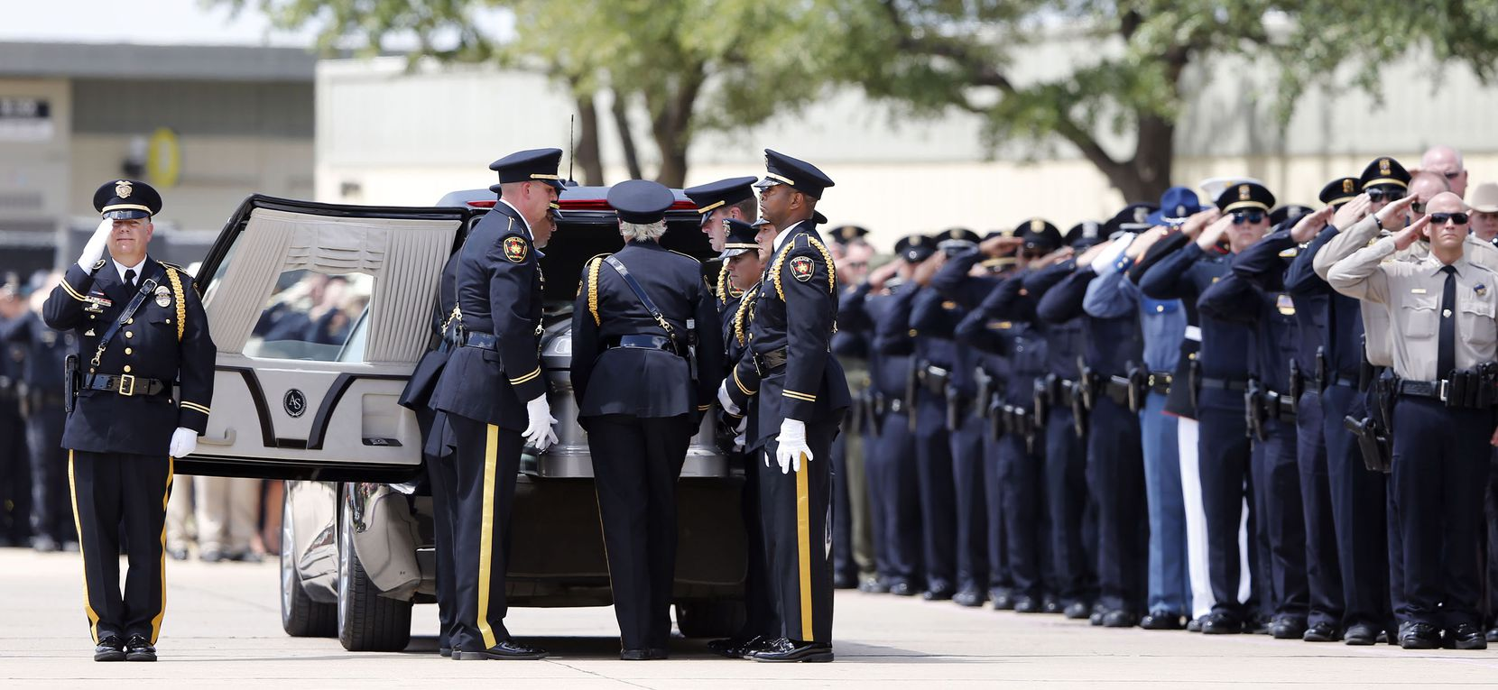 Arlington Honor Guard place DART Officer Brent Thompson inside the hearse during a memorial service at The Potter's House in Dallas on Wednesday, July 13, 2016. Thompson was one of five officers killed last week when a gunman opened fire during a Black Lives Matter rally in downtown Dallas.