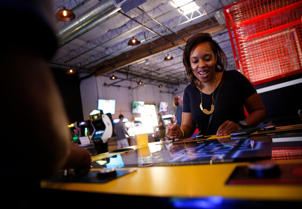 Tammy Morris plays Pac-Man at Cidercade in Dallas.