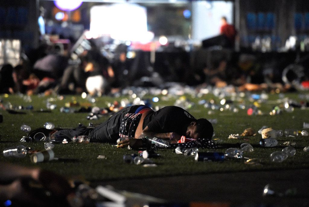 A person lies on the ground at the Route 91 Harvest country music festival after gunfire was heard in Las Vegas.