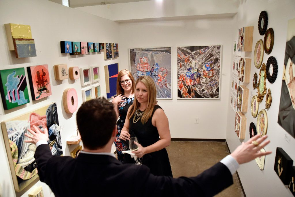 Jordan Roth (left), director of Ro2 Art, visits with Caitlin Overton (top) and Leigh Arnold, assistant curator of the Nasher Sculpture Center, at the Ro2 Art space at the gala. (Ben Torres/Special Contributor)