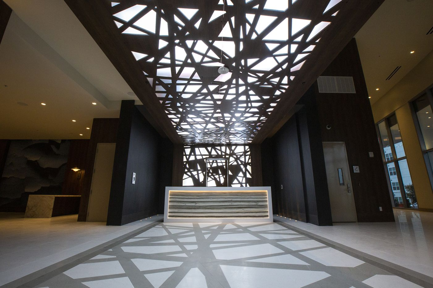 The concierge area at the new LVL 29 apartment high-rise in Plano. (Lynda M. Gonzalez/The Dallas Morning News)