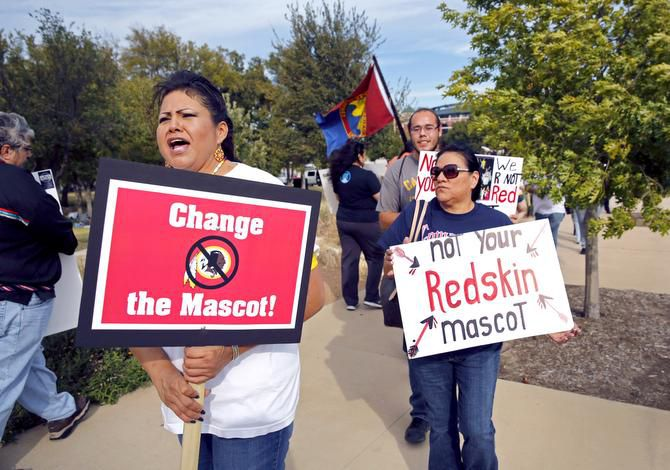 """Yolonda Blue Horse and other protesters rallied outside AT&T Stadium on Monday before the Cowboys-Redskins game, calling for Washington's team to change its nickname. """"This protest has been going on since the 1970s,"""" Blue Horse said."""