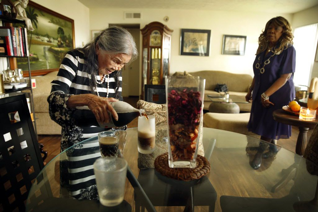 Senior companion Dorothy Jones (right), 71, joins  her client Lucila Oblena, 91, for a cold glass of soda following their walk at Lucila's Dallas apartment, Thursday, May 7, 2015.  Dorothy cares for Lucila daily (weekdays) as part of the Senior Source's Senior Companions program. (Tom Fox/The Dallas Morning News) 07142015xSeniorLiving