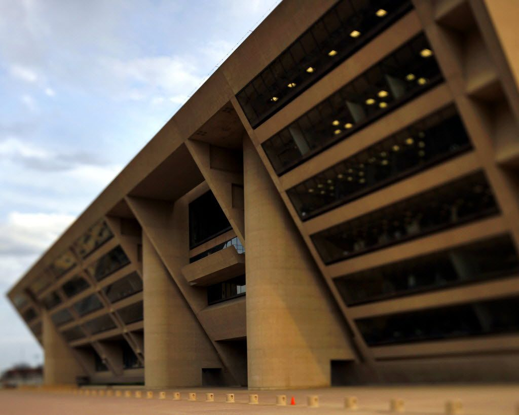 """Dallas is full of signature works from """"starchitects.""""  The """"brutalist"""" style pioneered by Le Corbusier, with bold geometries in cast-in-place concrete, came to Dallas with I.M. Pei's design of City Hall in 1977, highlighted by its forward-leaning facade, punctured by rounded stairwells."""