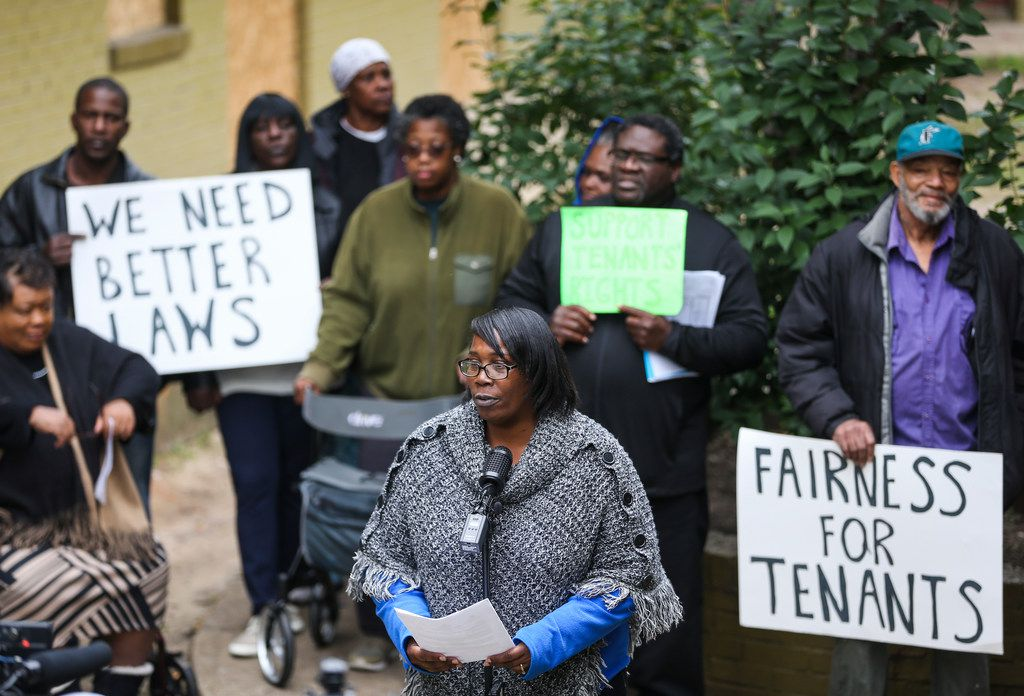 Odette Edwards, center, speaks at Bryan Song Apartments on Tuesday. Edwards, like all of the other residents of the complex, received an eviction notice to be out of her apartment by February 10.