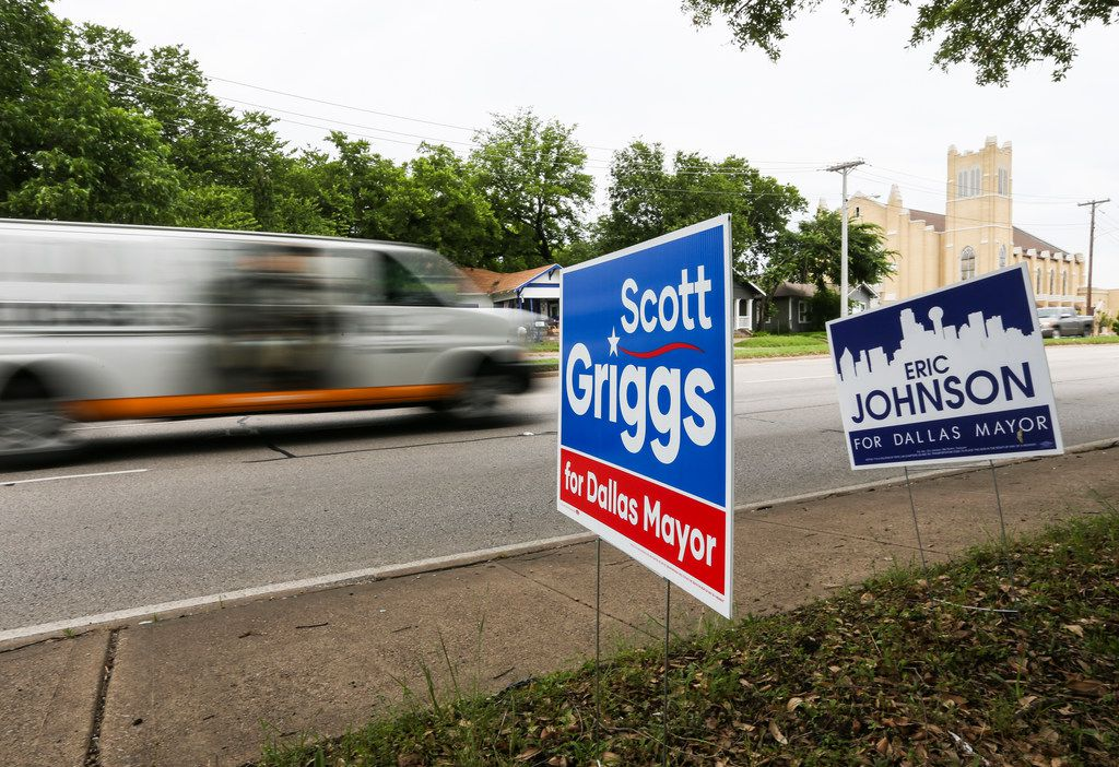 Campaign signs for candidates Scott Griggs and Eric Johnson, who are in a runoff for mayor of Dallas, are seen at the Samuell Grand Recreation Center polling place on the last day of early voting for runoff elections Tuesday, June 4, 2019 in Dallas. (Ryan Michalesko/The Dallas Morning News)