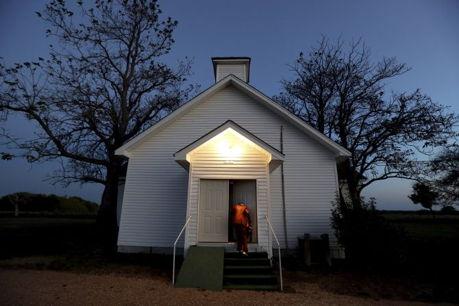 Darlene Holloway arrives for a church service in Pelham, one of the state's dwindling number of freedmen's communities. The residents of the town just outside Corsicana have collected artifacts and memories so the town won't fade away.