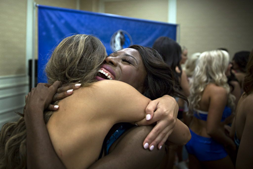 Bebe Jamabo (right) embraces Raegan Schmotzer at the news they made the final cut during final auditions to join the 2015-2016 Dallas Mavericks Dancers team Sunday, July 12, 2015 in Dallas. More than 40 women made it to the finals, vying for a spot to take part in a training camp later in the week.