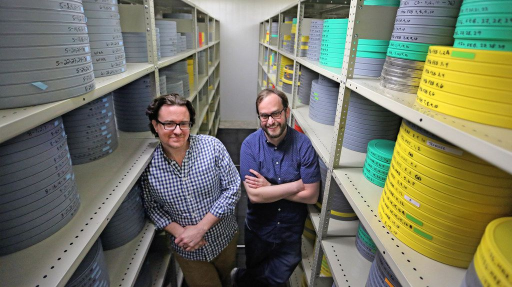 Curator Jeremy Spracklen and assistant curator Scott Martin in the 50-degree film vault beneath the SMU campus