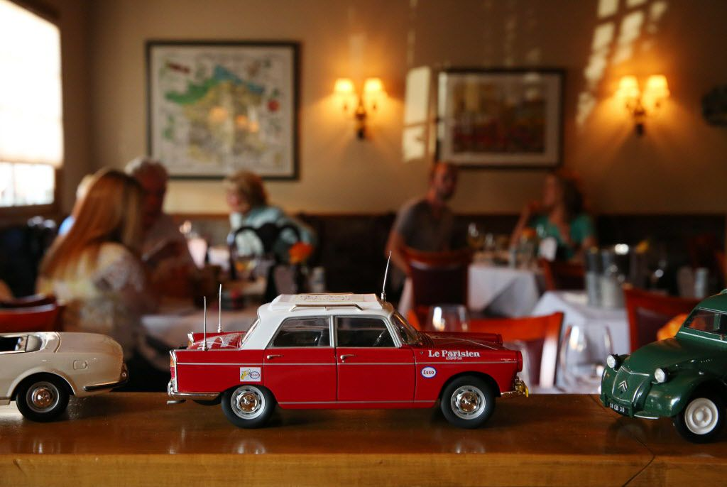 One of Tronche's model cars, with a view into the dining room