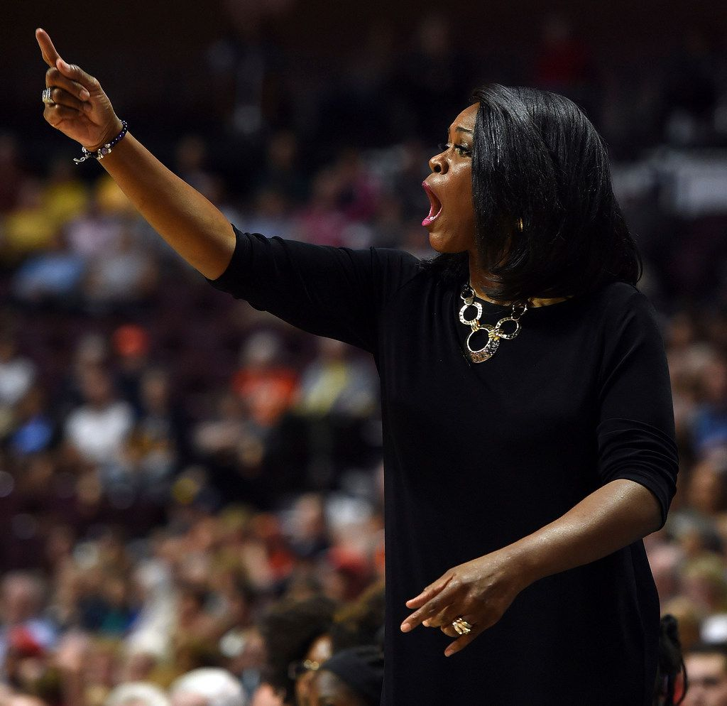 Dallas Wings head coach Taj McWilliams-Franklin calls out a play to her team as they play the Connecticut Sun in the first half of WNBA basketball action Tuesday, Aug. 14, 2018 at Mohegan Sun Arena in Uncasville, Conn. (Sean D. Elliot/The Day via AP)