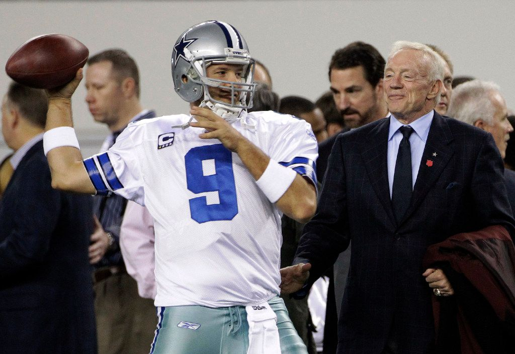 FILE - In this Sunday, Dec. 11, 2011 file photo, Dallas Cowboys owner Jerry Jones, right, watches as quarterback Tony Romo throws the ball before an NFL football game against the New York Giants in Arlington, Texas. Dallas Cowboys owner and general manager Jerry Jones anticipates Tony Romo being on the roster next year even though the 36-year-old quarterback has lost the starting job for now to rookie Dak Prescott, Thursday, Nov. 17, 2016. (AP Photo/Tony Gutierrez, File)