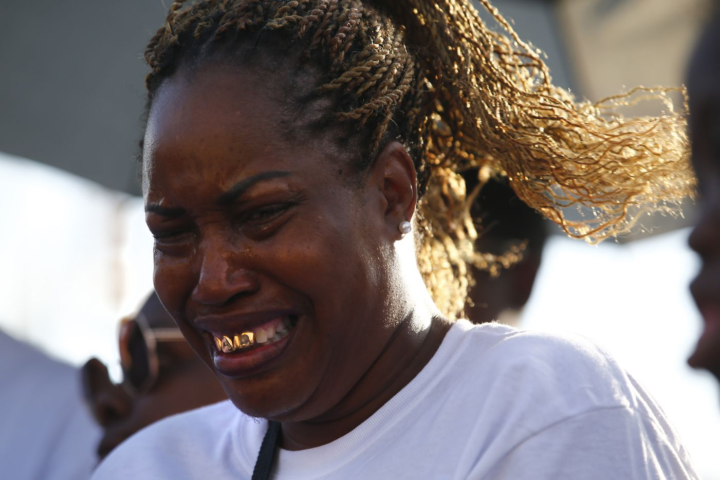 Shavon Randle's aunt Jessie Randle cries during the vigil in Dallas on July 3, 2017.