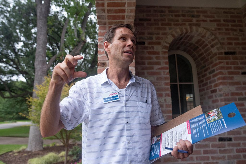 Nathan Johnson talks to a homeowner as he canvassed a neighborhood on Monday, Sept. 3, 2018.  He is running against Don Huffines for the Texas Senate in District 16.