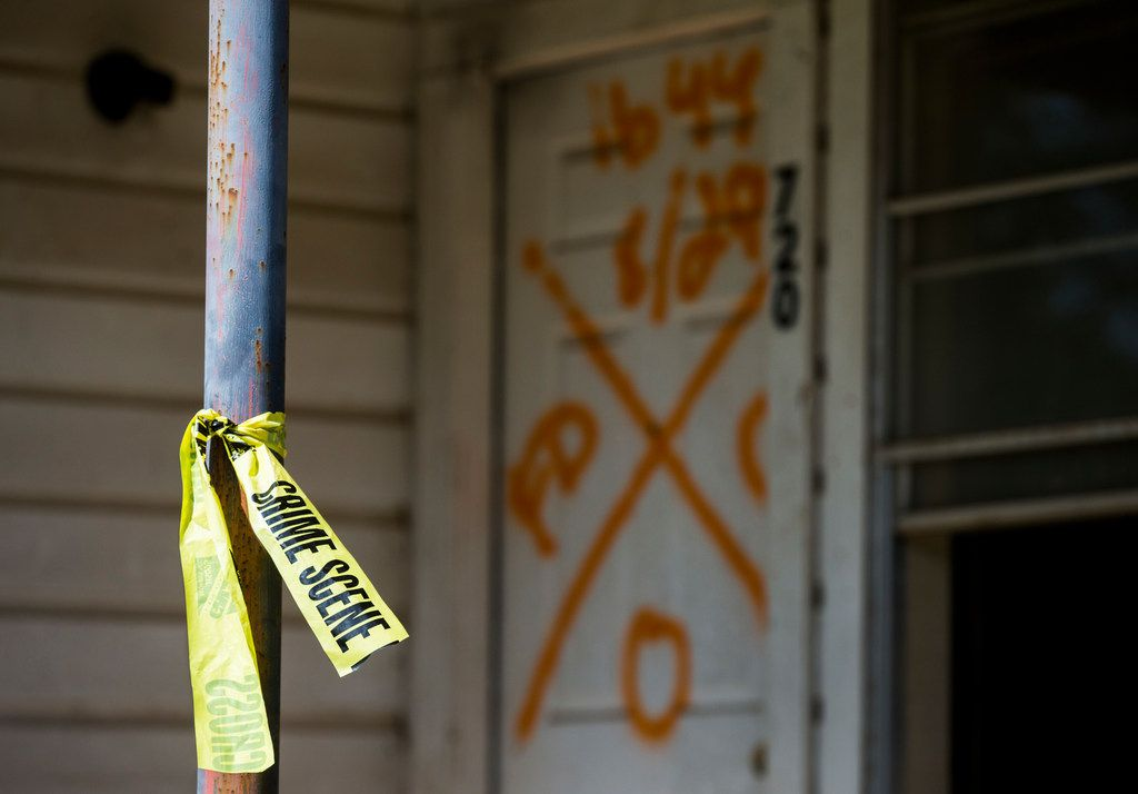 Crime scene tape and an X showing the date, time and number of people found dead, which was zero, was spray painted on the front door of a home on Colorado Street on Wednesday, October 11, 2017 in La Grange, Texas. Major flooding damaged hundreds of homes in the city due to flooding from Hurricane Harvey in late August. Record amounts of rain caused the Colorado River, which borders La Grange, to raise up about 54 feet. (Ashley Landis/The Dallas Morning News)