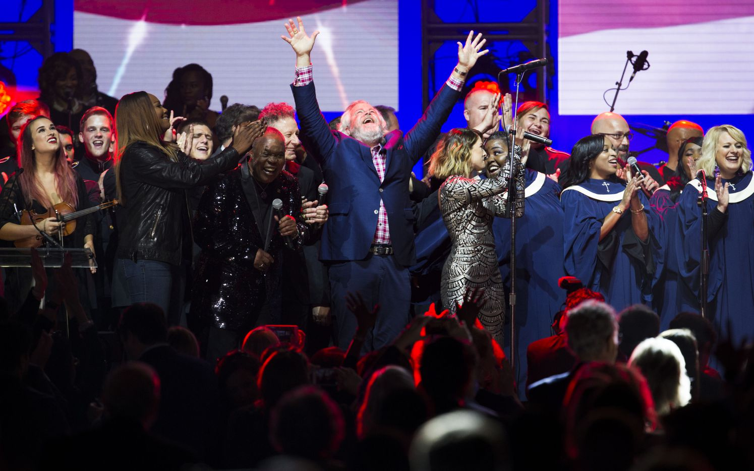 Yolanda Adams, Sam Moore, Lyle Lovett, Robert Earl Keen, Cassadee Pope and other performers celebrate on stage during the finale of Deep from the Heart: The One America Appeal Concert on Saturday, October 21, 2017 at Reed Arena on the Texas A&M University campus in College Station, Texas.