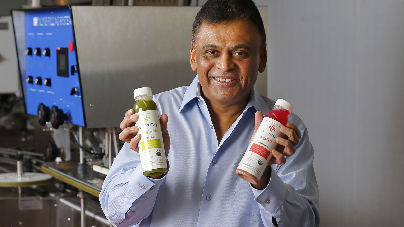 Vim Vitae CEO Nick Mysore poses with some of their natural, organic juices they produce at their Dallas facility, Wednesday, January 18, 2017. Mysore, who is a veteran of Dean Foods and ConAgra, was hired to turn Vim Vitae, a Dallas-based healthy juice company, into a national brand after a private equity investment. (Tom Fox/The Dallas Morning News)