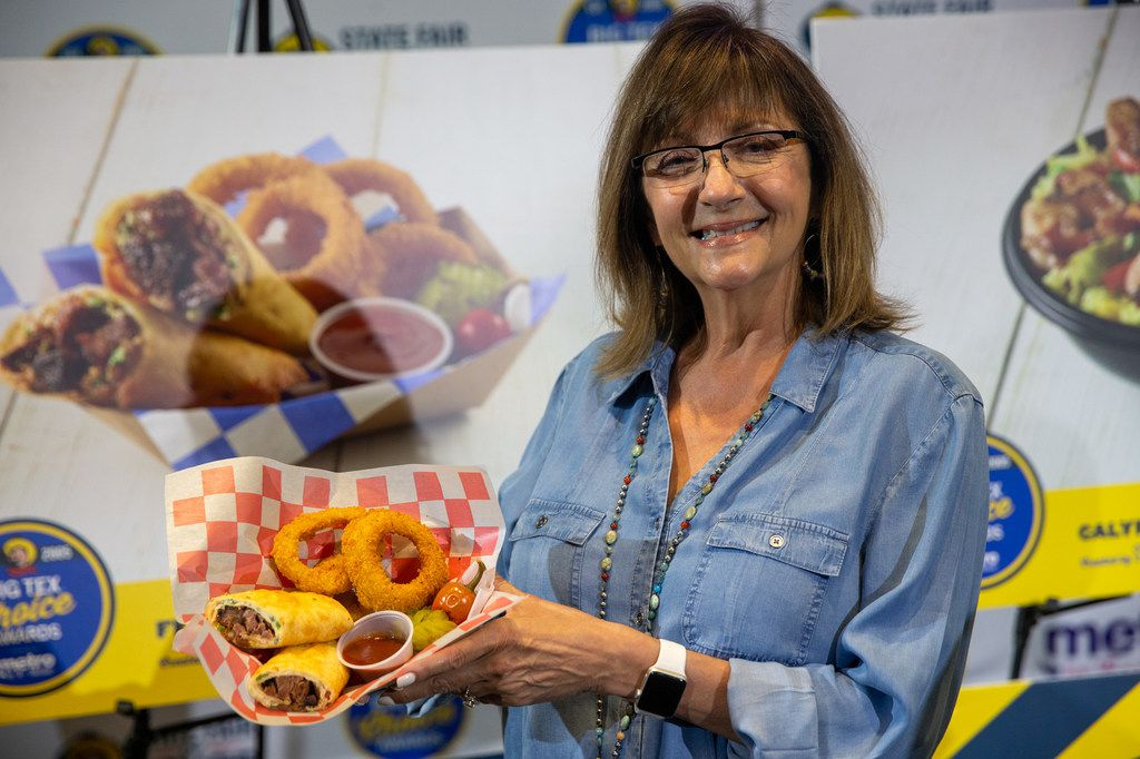 Christi Erpillo holds up Fernie's Fried Burnt End Burrito during the unveiling of the Big Tex Choice Awards. Erpillo has worked at the fair since she was a teenager.