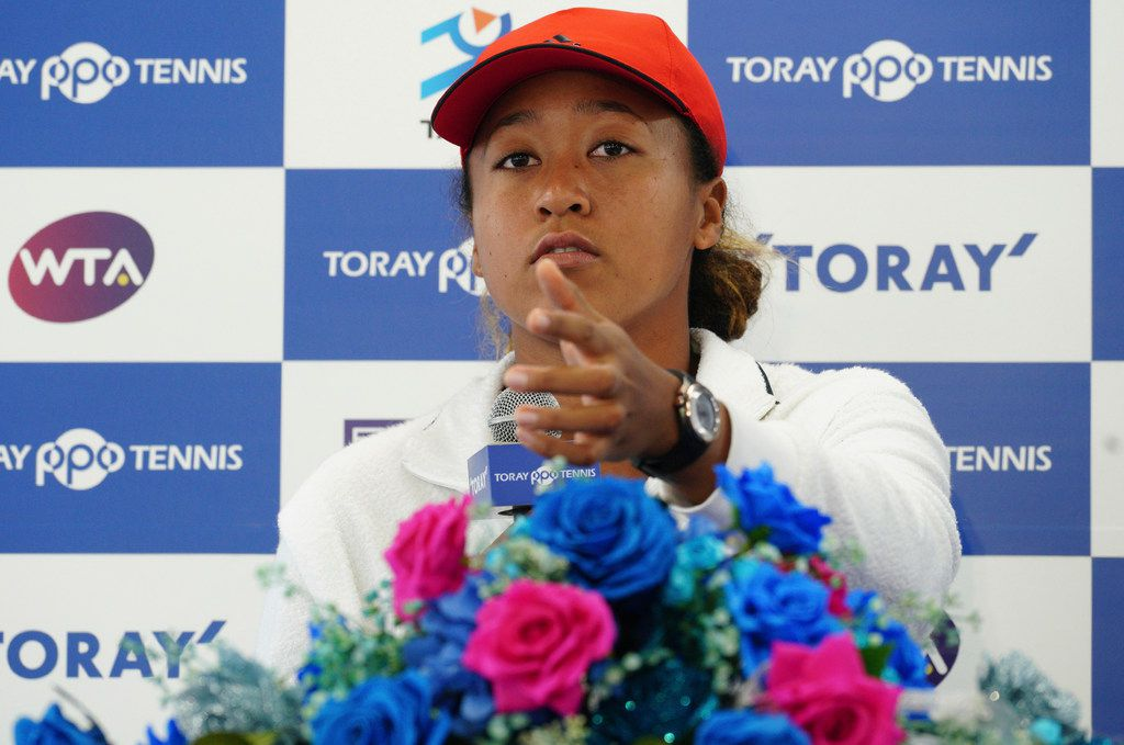 U.S. Open women's singles champion Naomi Osaka gestures during a press conference prior to the Pan Pacific Open tennis tournament in Tokyo on Sept. 17.
