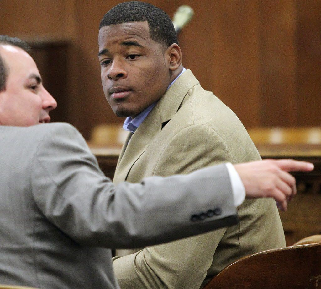 In this Jan. 23, 2014, file photo, former Baylor football player Tevin Elliott waits with a unidentified lawyer in a McLennan county courtroom in Waco, Texas.