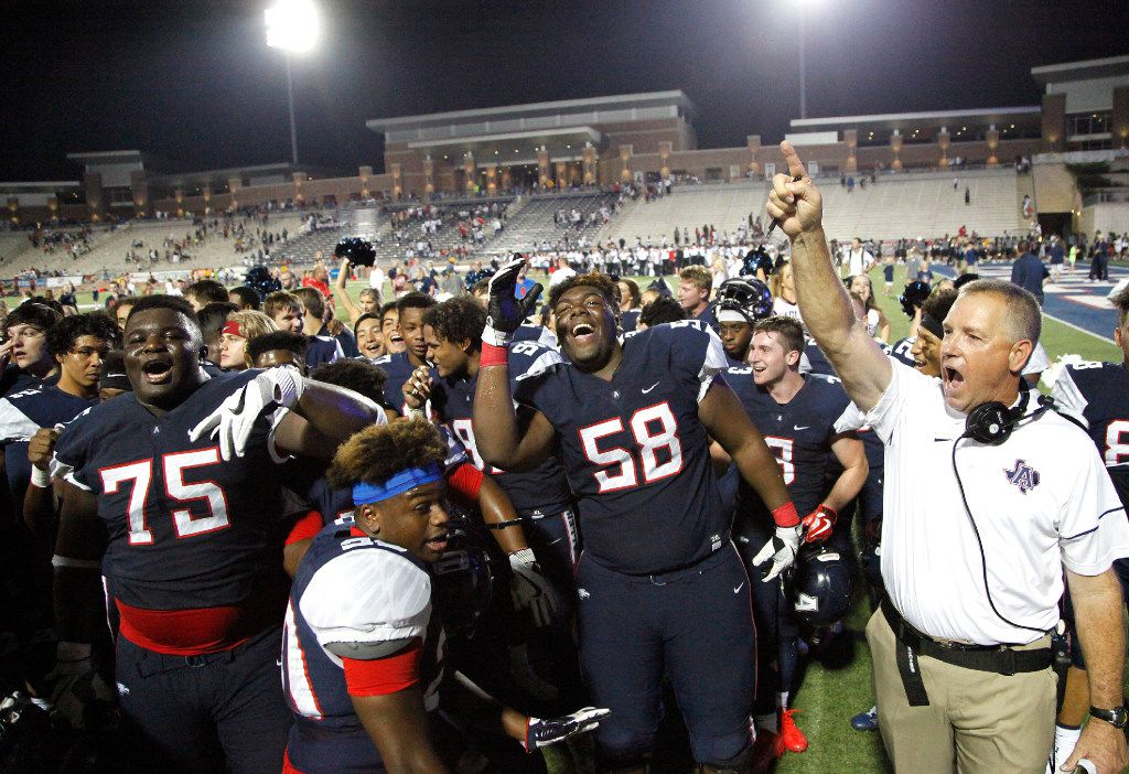 Allen offensive lineman E.J. Ndoma-Ogar (75) and linebacker Tai Brooks (58) dance while head coach Terry Gambill hoists his finger up after Allen High School got their first victory 23-8 as Allen High School hosted Cedar Hill High School in a football game at Eagle Stadium on Friday night, September 1, 2017. (Stewart F. House/Special Contributor)