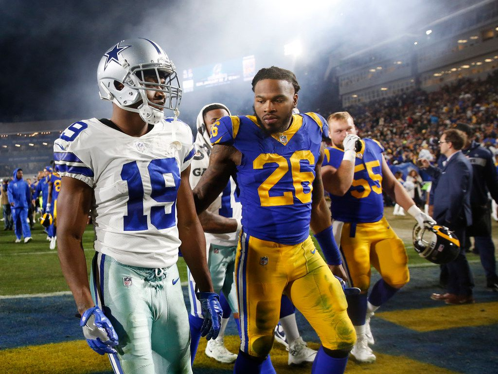 Dallas Cowboys wide receiver Amari Cooper (19) gets a pat on the back from Los Angeles Rams inside linebacker Mark Barron (26) after losing to Los Angeles Rams in the NFC divisional round playoff game at Los Angeles Memorial Coliseum in Los Angeles, Calif. on Saturday, Jan. 12, 2019. The Dallas Cowboys lost 22-30. (Rose Baca/Staff Photographer)