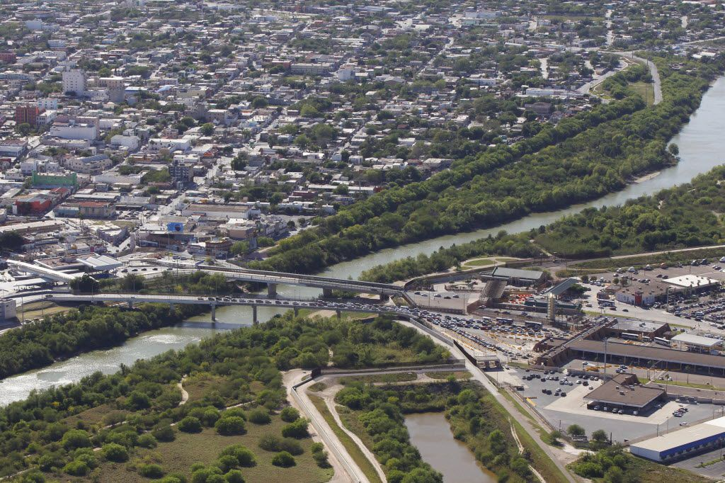 Reynosa, Mexico, left, and the Hidalgo Port of Entry on the Mcallen-Hidalgo-Reynosa International Bridge across the Rio Grande river in the U.S. on Thursday March 24, 2016 in Hidalgo, Texas. Reynosa is not only a gateway for business between the U.S. and Mexico, it's also a dangerous city where drug cartels prey on migrants who are trying to enter the U.S. both legally and illegally.