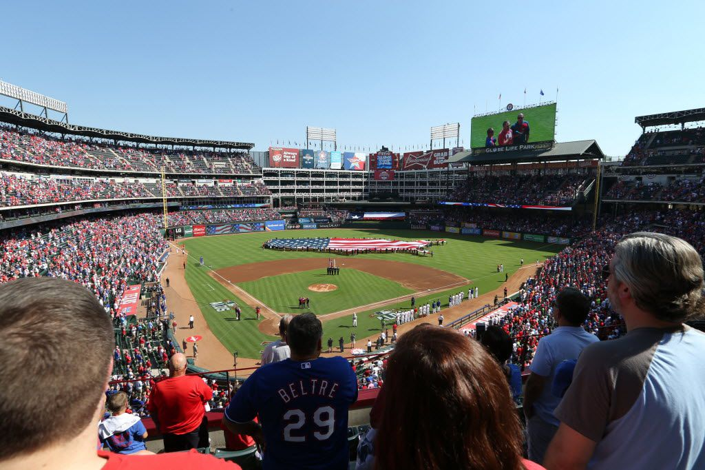 Fans sing along to the national anthem before the Texas Rangers and Toronto Blue Jays play game 4 of the American League Division Series at Globe Life Park in Arlington on Monday, October 12, 2015. (Vernon Bryant/The Dallas Morning News)