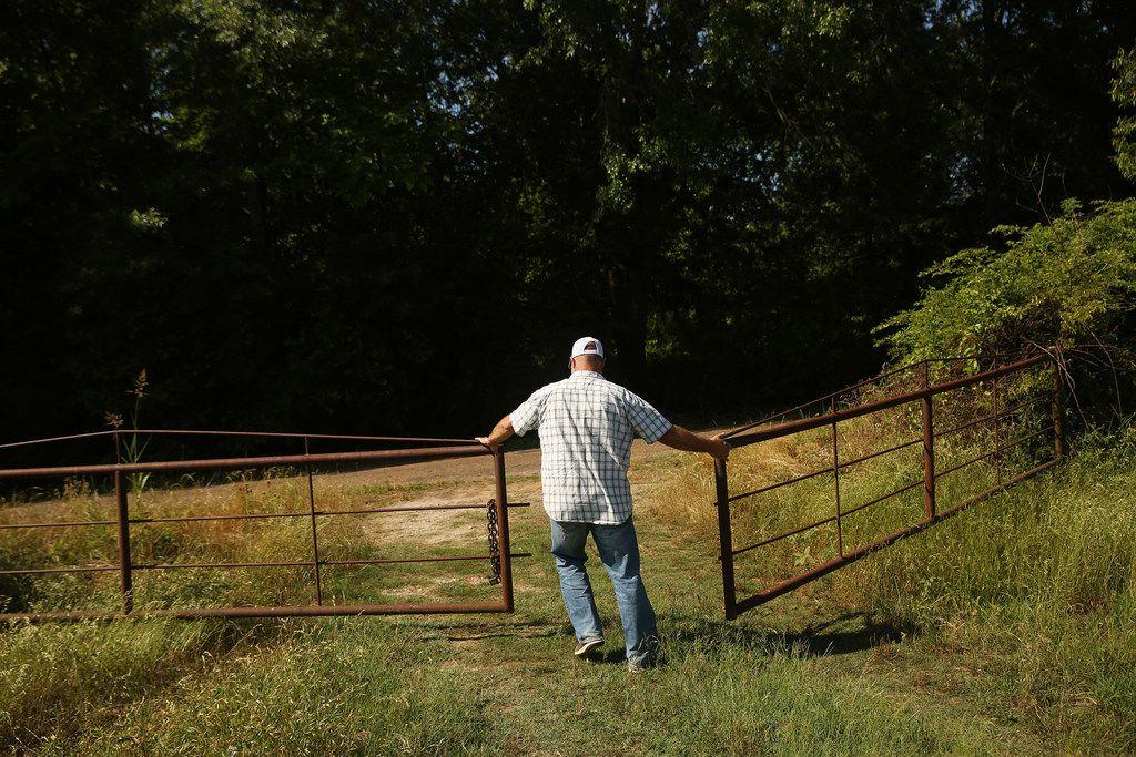 Doug Williams closes the gate at Grow It Forward Farm in Edom.