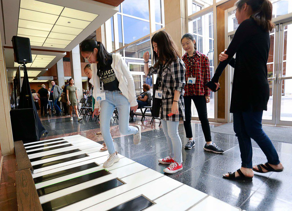 Contestants and participants play on the Cliburn electronic piano during the quarterfinal round on Sunday as part of the Cliburn International Junior Piano Competition and Festival in Caruth Auditorium on the campus of SMU in Dallas.