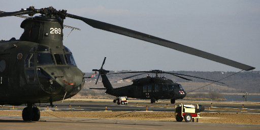 Chinook and Blackhawk helicopters of the Texas Army National Guard, stand ready to fight wildfires at their base located the Dallas Naval Air Station in Grand Prairie on Thursday, January, 31, 2008.