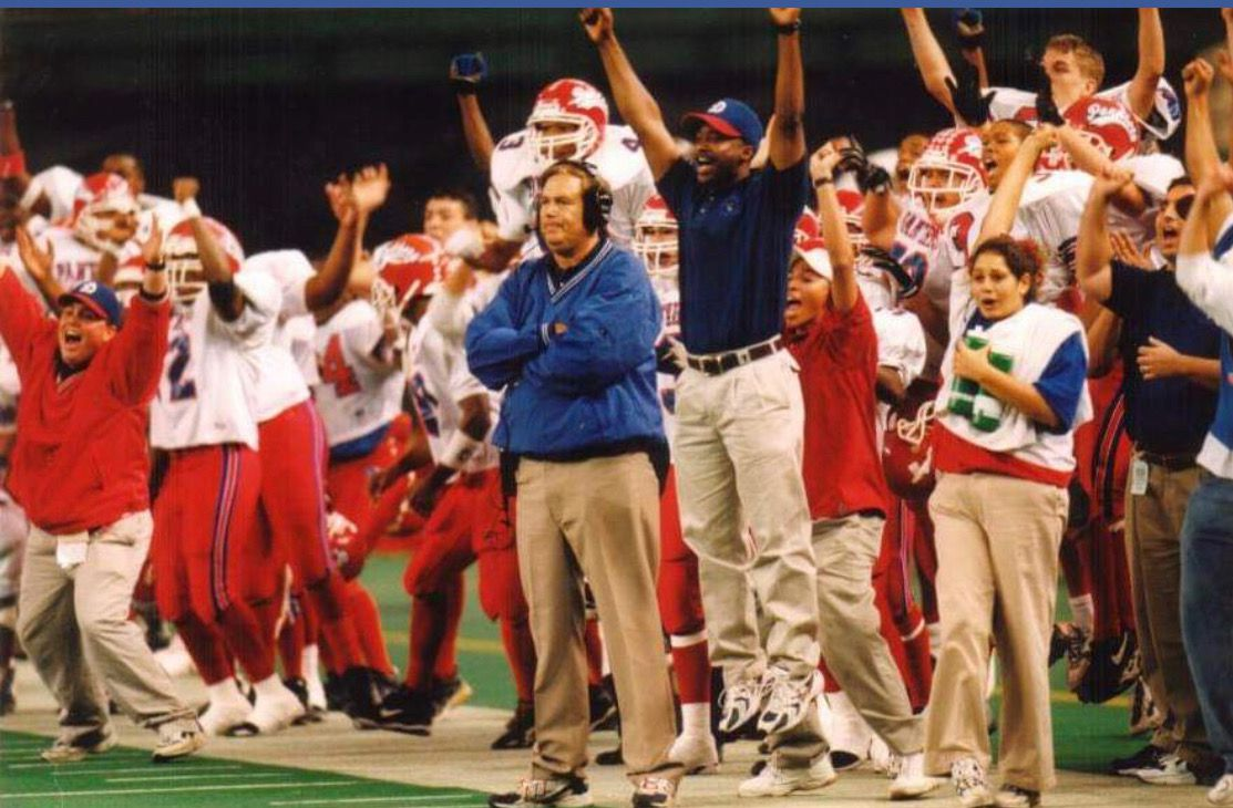The Duncanville sideline celebrates as the Panther defense makes a key stop during the 1998 Class 5A Division I state final game.