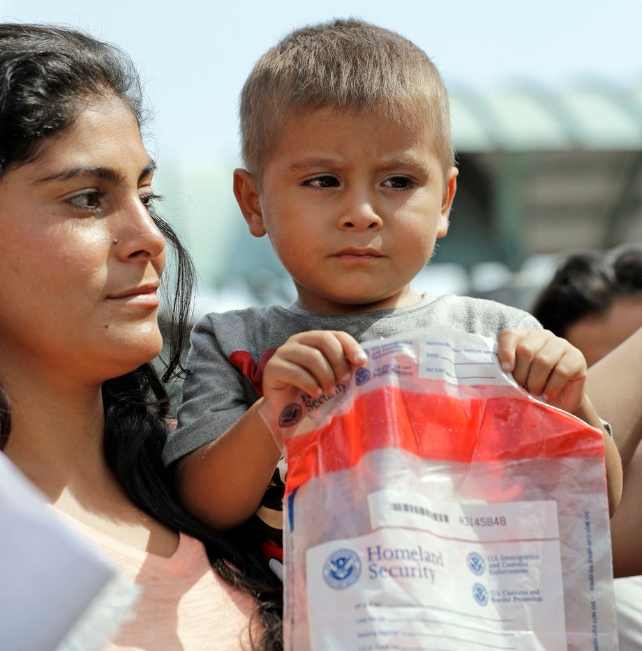 An immigrant child holds bag from Homeland Security as he arrives at the bus station after being processed and released by U.S. Customs and Border Protection, Friday, June 22, 2018, in McAllen, Texas.