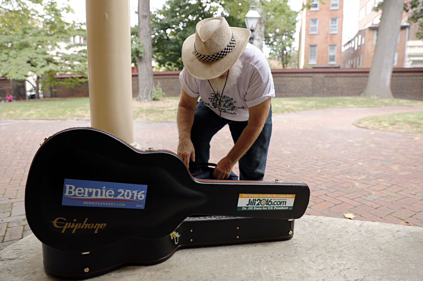 Rodney Hytonen of Pennsboro, West Virginia, checks on his guitar during the People's Convention.
