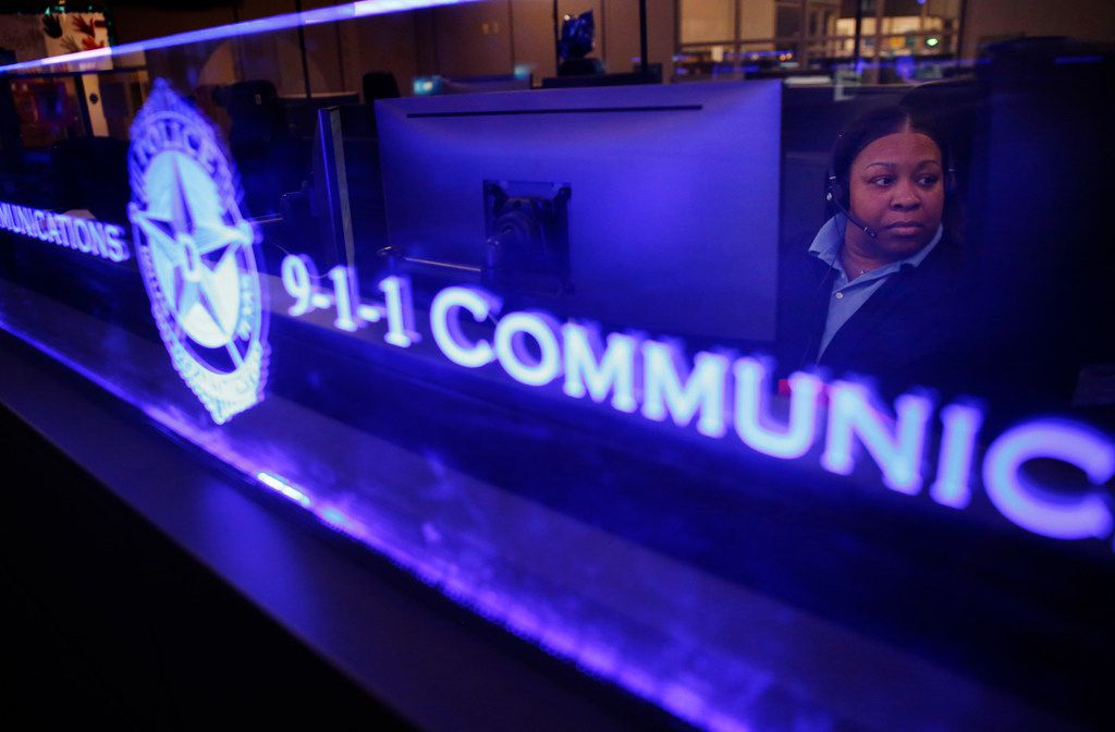 Kesha Williams, a 911 call taker, works in the Dallas Police 911 call center at Dallas City Hall.