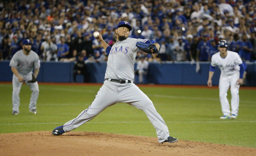 Texas Rangers starting pitcher Yovani Gallardo (49) throws a fourth-inning pitch during Texas' 5-3 win in Game 1 of the ALDS between the Texas Rangers and the Toronto Blue Jays  at Rogers Centre in Toronto, Canada on Thursday, October 8, 2015. (Louis DeLuca/The Dallas Morning News)
