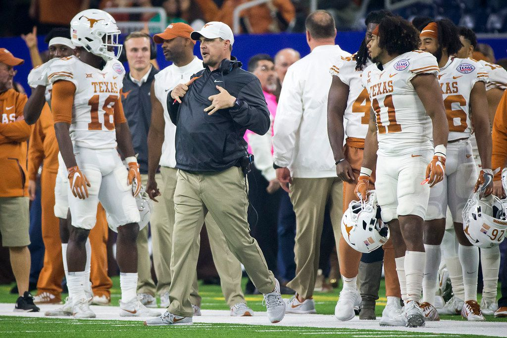 Texas head coach Tom Herman celebrates with his players during the final minute of a win over Missouri the Texas Bowl on Wednesday, Dec. 27, 2017, in Houston. (Smiley N. Pool/The Dallas Morning News)