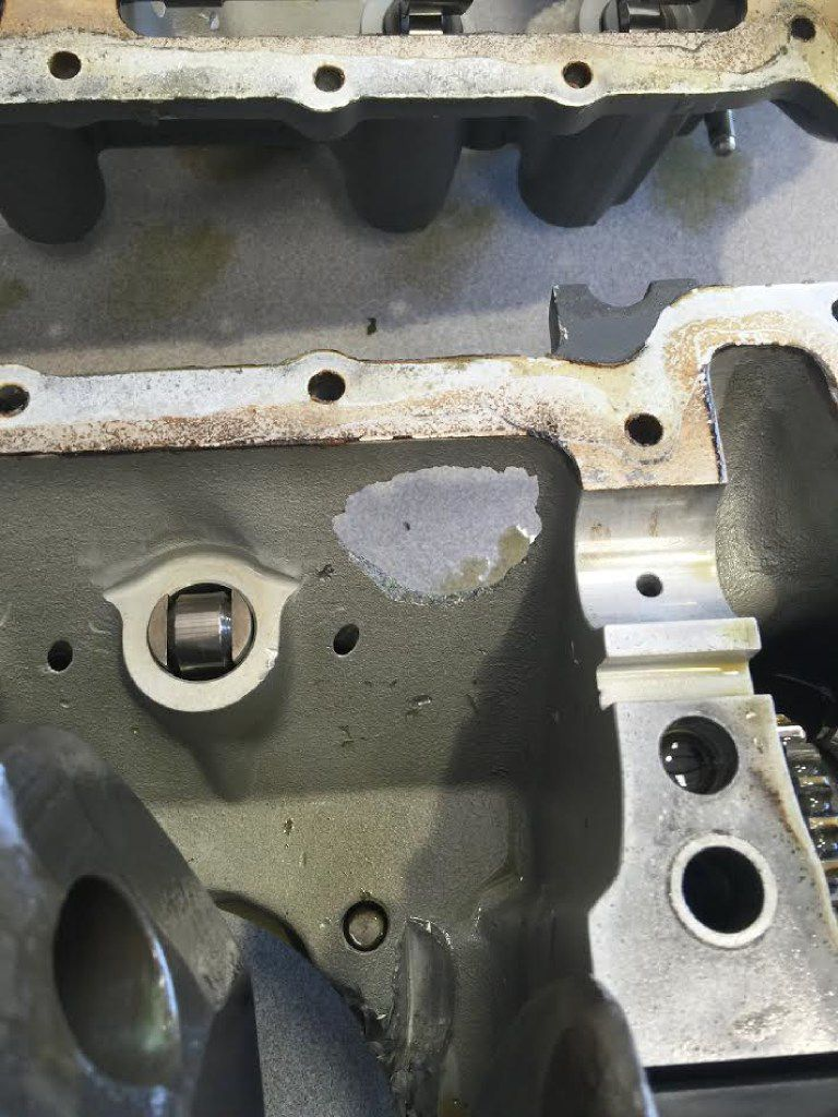 A photo provided by the FAA shows a hole (center) in the engine casing of the Cessna 172RG that made an emergency landing at Addison Airport. (FAA)