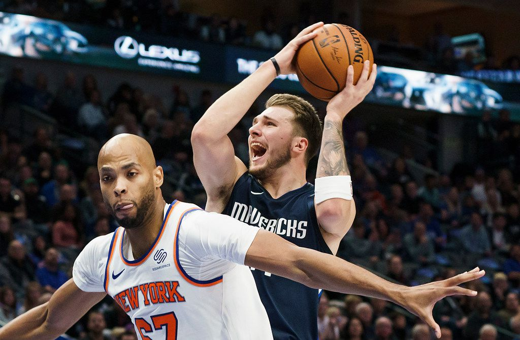 Dallas Mavericks guard Luka Doncic (77) drives to the basket past New York Knicks forward Taj Gibson (67) during the first half of an NBA basketball game at American Airlines Center on Friday, Nov. 8, 2019, in Dallas. (Smiley N. Pool/The Dallas Morning News)