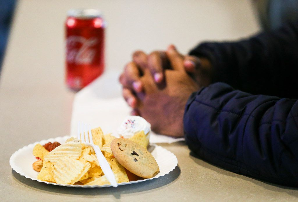 Students in the class eat typical Super Bowl snacks: chips, sweets, soda and the like.