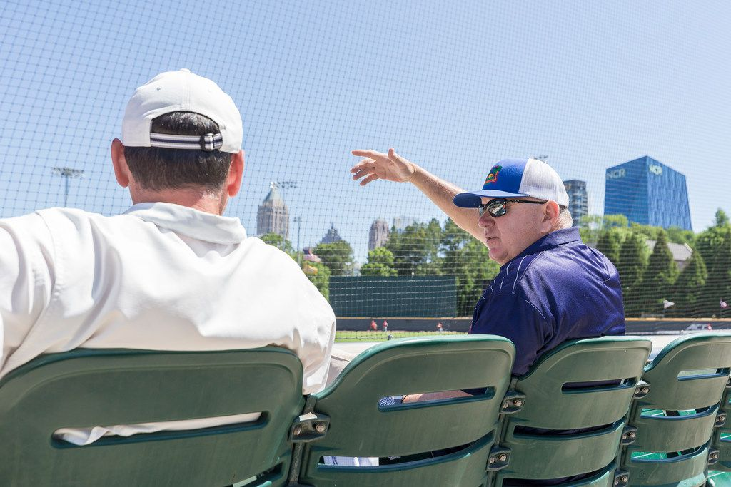 FILE - Texas Rangers area scout, Derrick Tucker, left, and  Senior Director of Amateur Scouting Kip Fagg during an NCAA baseball game between Radford and Georgia Tech, Sunday, May 6, 2018, in Atlanta.