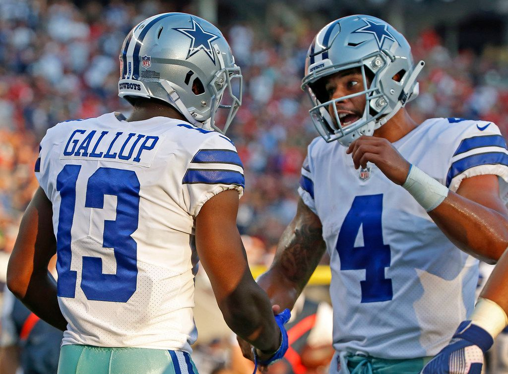 Dallas Cowboys wide receiver Michael Gallup (13) is congratulated by quarterback Dak Prescott after he catches a touchdown pass during the first quarter of the pre-season game against Francisco 49ers at Levi's Stadium in Santa Clara, Calif., Thursday, Aug. 9, 2018. (Jae S. Lee/The Dallas Morning News)