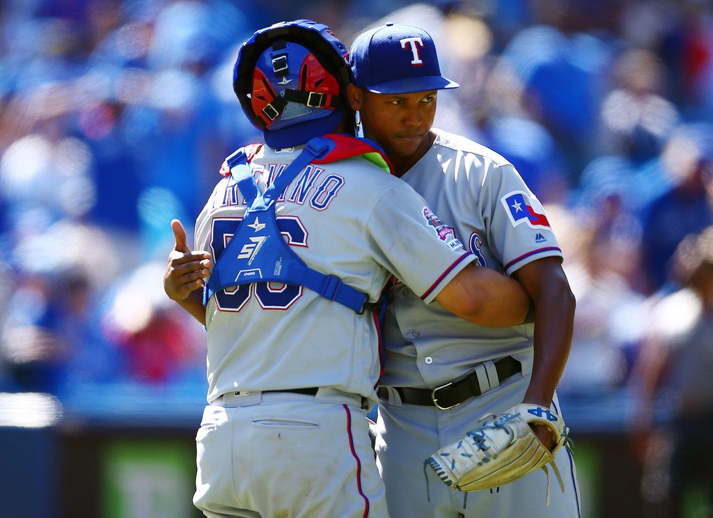 Texas Rangers catcher Jose Trevino embraces closer Jose Leclerc after wrapping up a 7-3 win over the Toronto Blue Jays on Aug. 14 at Rogers Centre in Toronto.