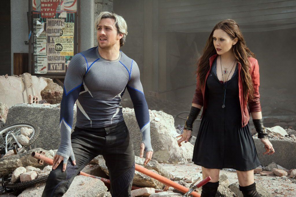 """This photo provided by Disney/Marvel shows, Aaron Taylor-Johnson, left, as Quicksilver/Pietro Maximoff , and Elizabeth Olsen as Scarlet Witch/Wanda Maximoff, in a scene from the film, """"Avengers: Age of Ultron."""""""