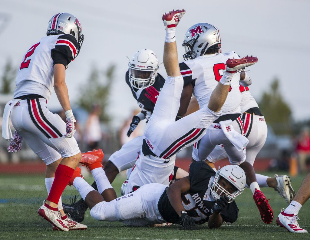 Flower Mound Marcus wide receiver Alex Fontaine (6) is upended by Arlington Bowie defensive back Kameron Sanders (27) during the first quarter of a high school football game between Flower Mound Marcus and Arlington Bowie on Thursday, August 29, 2019 at Wilemon Field in Arlington. (Ashley Landis/The Dallas Morning News)