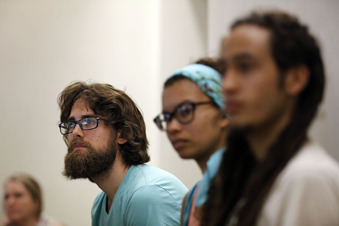 Patrick Moran of Abington Township, Pa., listens to a lecture on community organizing during the People's Convention.