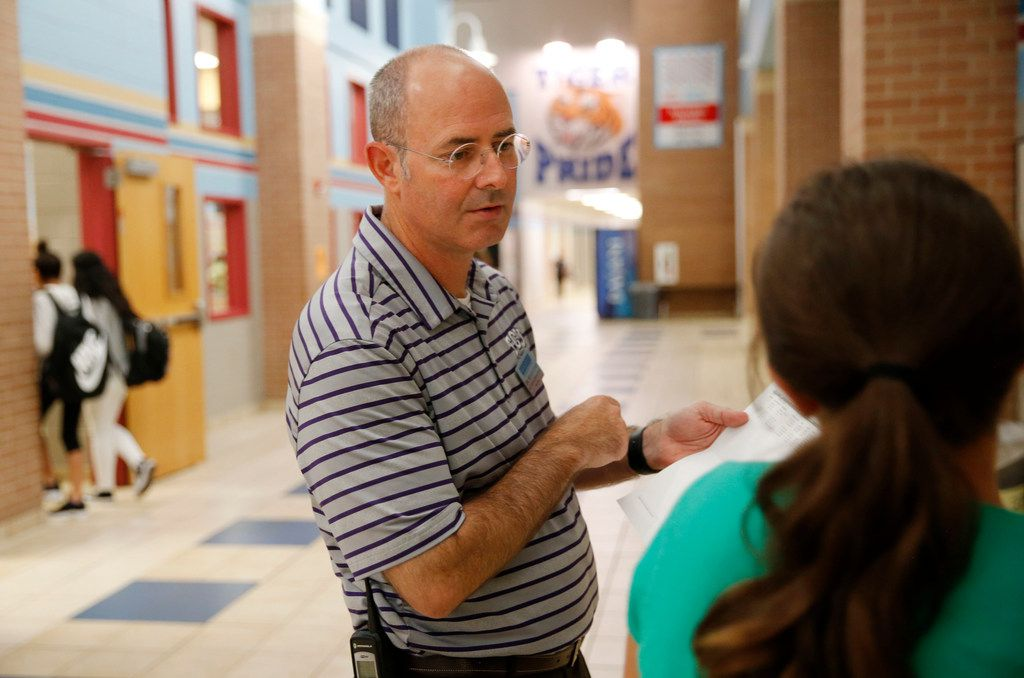 Principal Mitch Curry talks to a student who didn't know which class to go to next at Scott Johnson Middle School in McKinney.