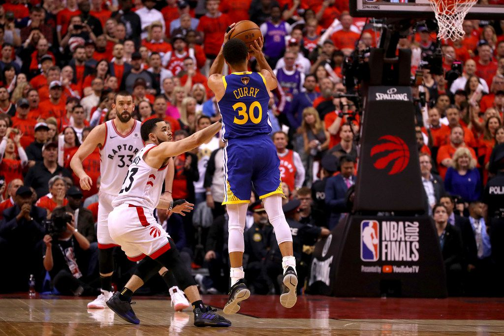 TORONTO, ONTARIO - JUNE 10:  Stephen Curry #30 of the Golden State Warriors attempts a shot against the Toronto Raptors in the second half during Game Five of the 2019 NBA Finals at Scotiabank Arena on June 10, 2019 in Toronto, Canada. NOTE TO USER: User expressly acknowledges and agrees that, by downloading and or using this photograph, User is consenting to the terms and conditions of the Getty Images License Agreement. (Photo by Gregory Shamus/Getty Images)